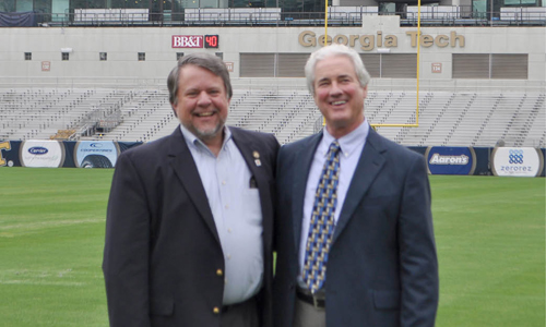 Two male Capitol Jackets steering committee members on Grant Field at Bobby Dodd Stadium